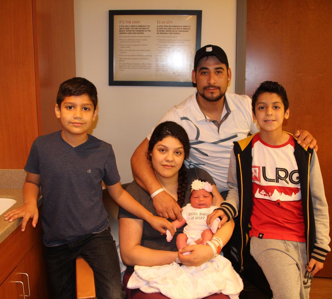 Parents Gustavo Lomeli and Nalleli Curiel, along with their two sons, welcome, baby girl, Citlaly, the 100th baby born at Iowa Specialty Hospital in 2017.