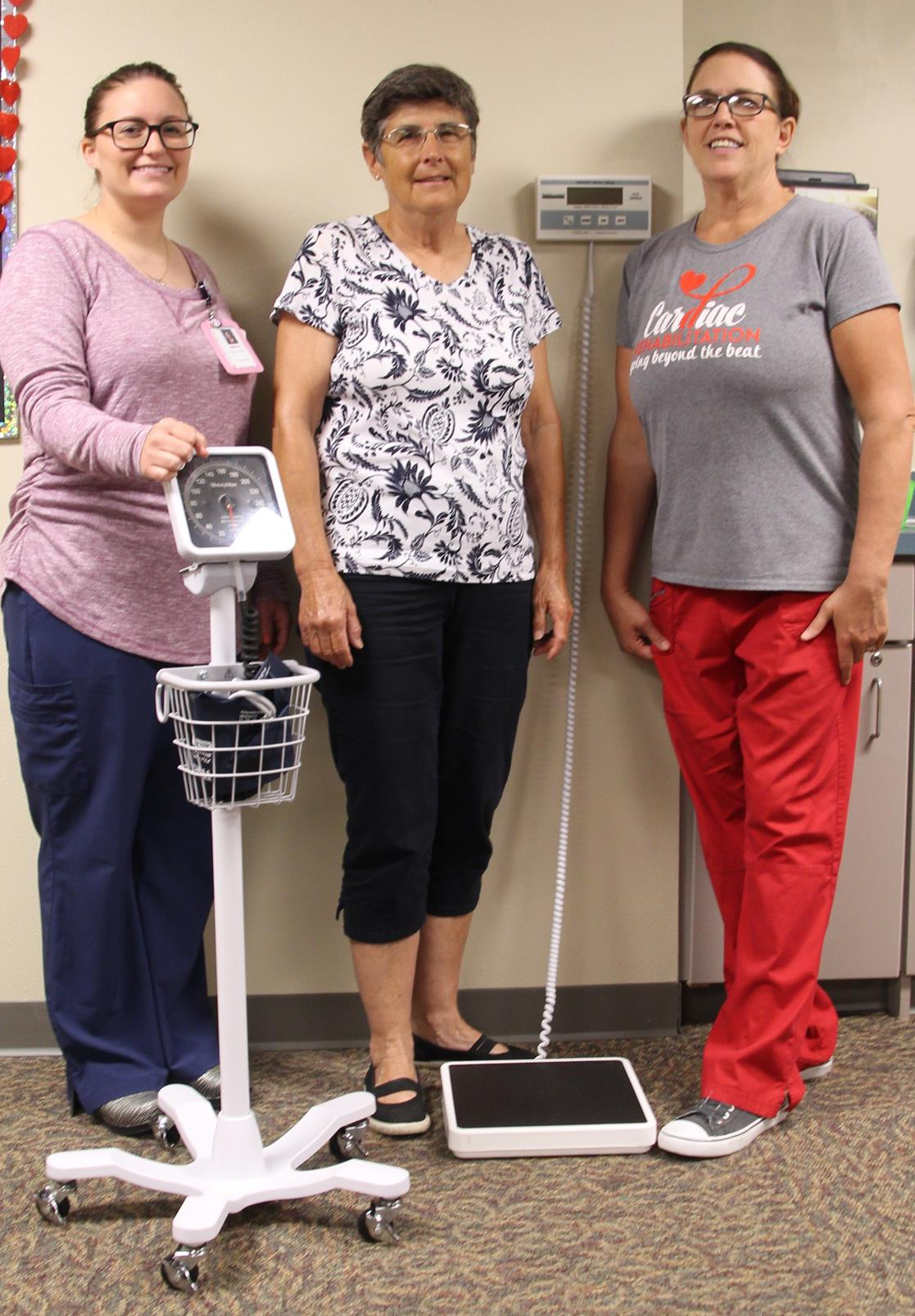 Picture with new cardiac rehab equipment made possible by the Johnson family's donation are Emily Weets, RN, Donna Johnson, and Trish Jensen, RN.