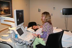 Patient receiving ultrasound at Iowa Specialty Hospitals & Clinics