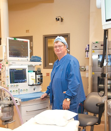 an RN first assistant standing by equipment in operation room