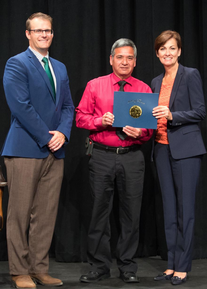 Lieutenant Governor Adam Gregg, Rey Solis, and Governor Kim Reynolds
