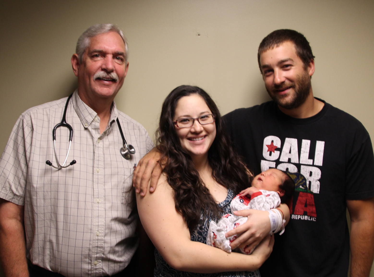 Pictured L to R:  Dr. Mike Whitters with parents Waylinn Rosenbaum and Joe Harrah and their son, Charles Harrah.
