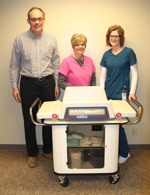 Duane Abse, Foundation Planned Giving Officer, and Clarion Clinic nurses, Kim Disney and Tricia Polzin, are shown with the new pediatric scale made possible by the Iowa Specialty Hospital Foundation – Clarion.